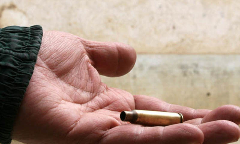 A man holding a bullet casing. — AFP/ File