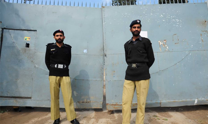 Policemen stand guard outside a prison in Rawalpindi — AFP/File