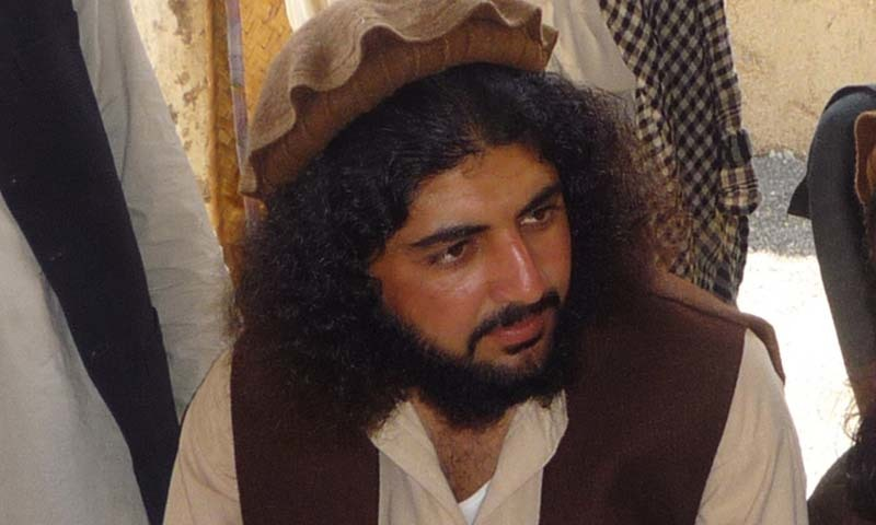 In this Oct. 4, 2009 photo, Pakistani Taliban commander Latif Mehsud sits with fellows in Sararogha in south Waziristan in Pakistan. – AP