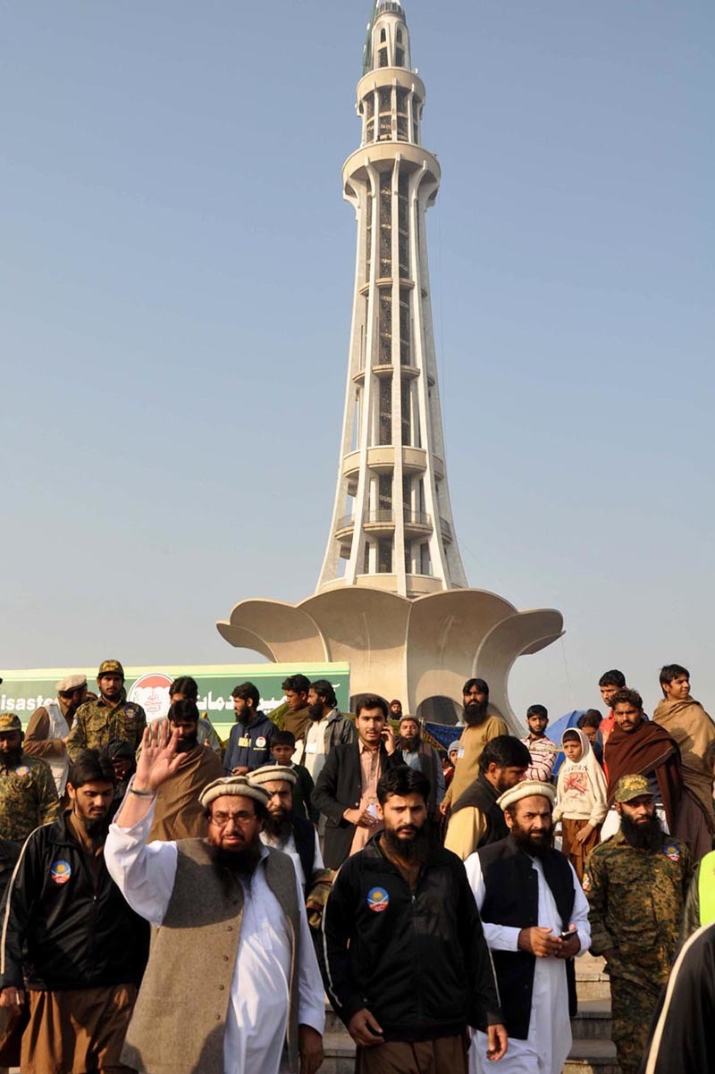 Hafiz Muhammad Saeed, waves to his supporters during congregation at Minar-i-Pakistan ground. — INP