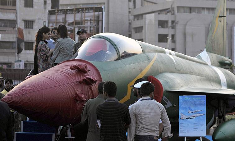 Visitors look at a PAC JF-17 Thunder multirole combat aircraft, - AFP