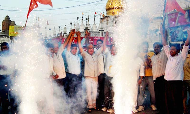 The file photo shows Hindu nationalists celebrate with fire crackers after Ayodhya verdict in Amritsar, India.—AP/File