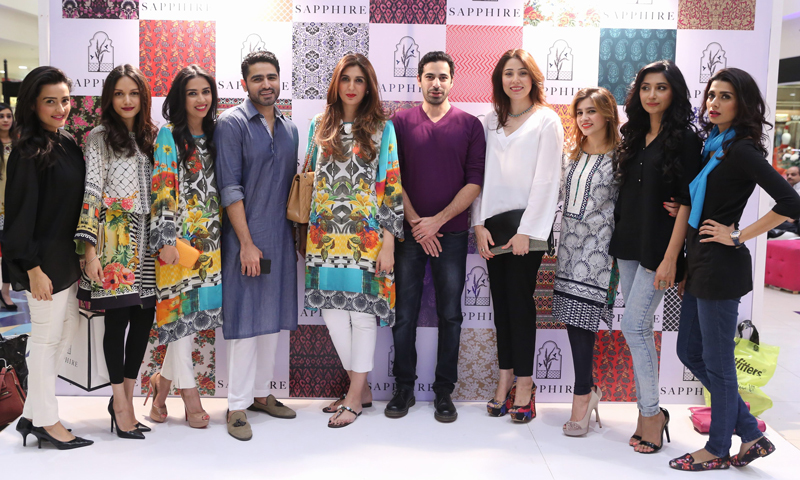 Khadija Shah poses with guests and models at the launch. - Photo courtesy: Kashif-ud-Din.