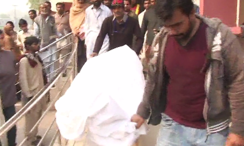 PTI activists carrying body of deceased PTI worker. - Screengrab from DawnNews