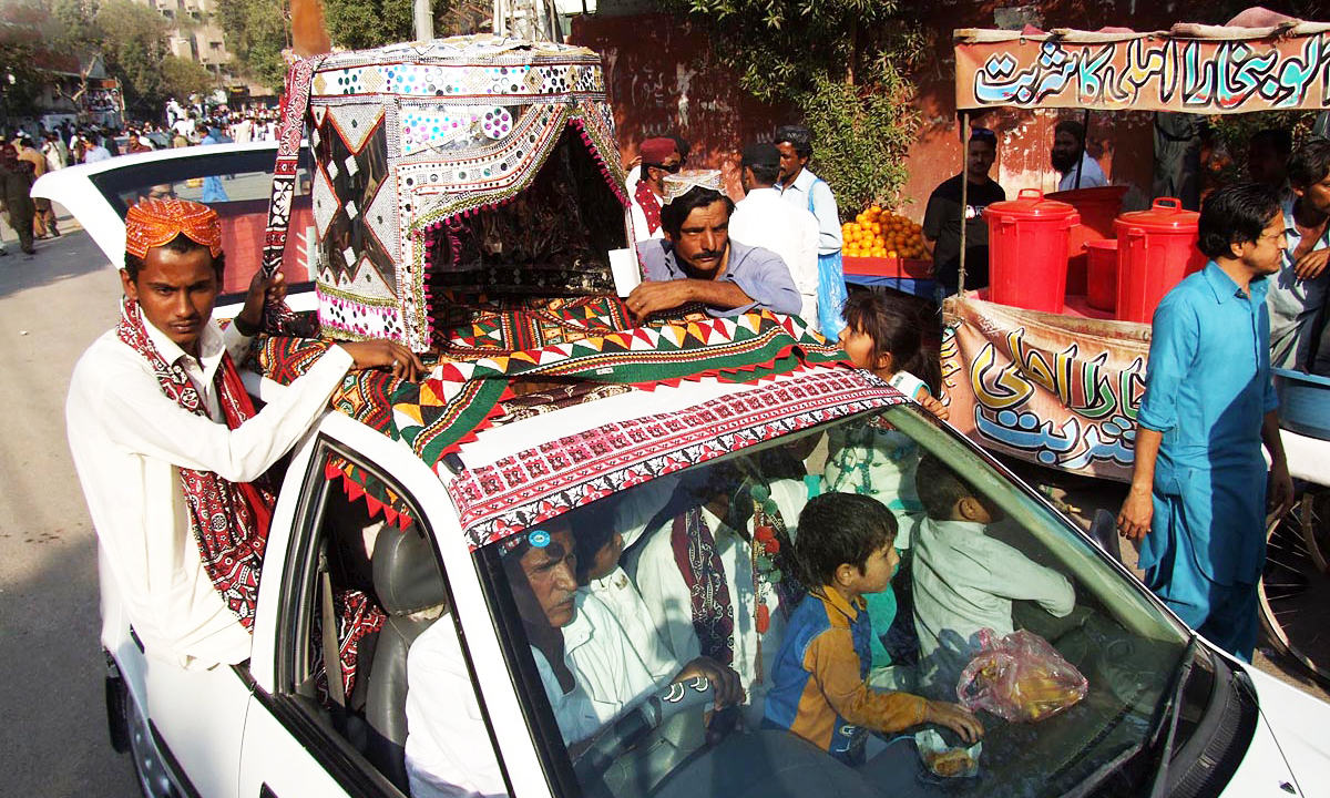 A car decorated with the Sindhi topi. — ONLINE