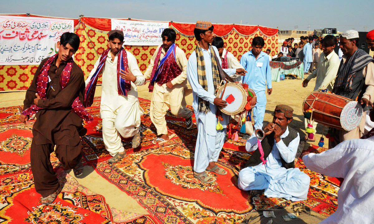 People celebrate Sindhi Topi Ajrak Day, in Dera Allah Yar. — ONLINE