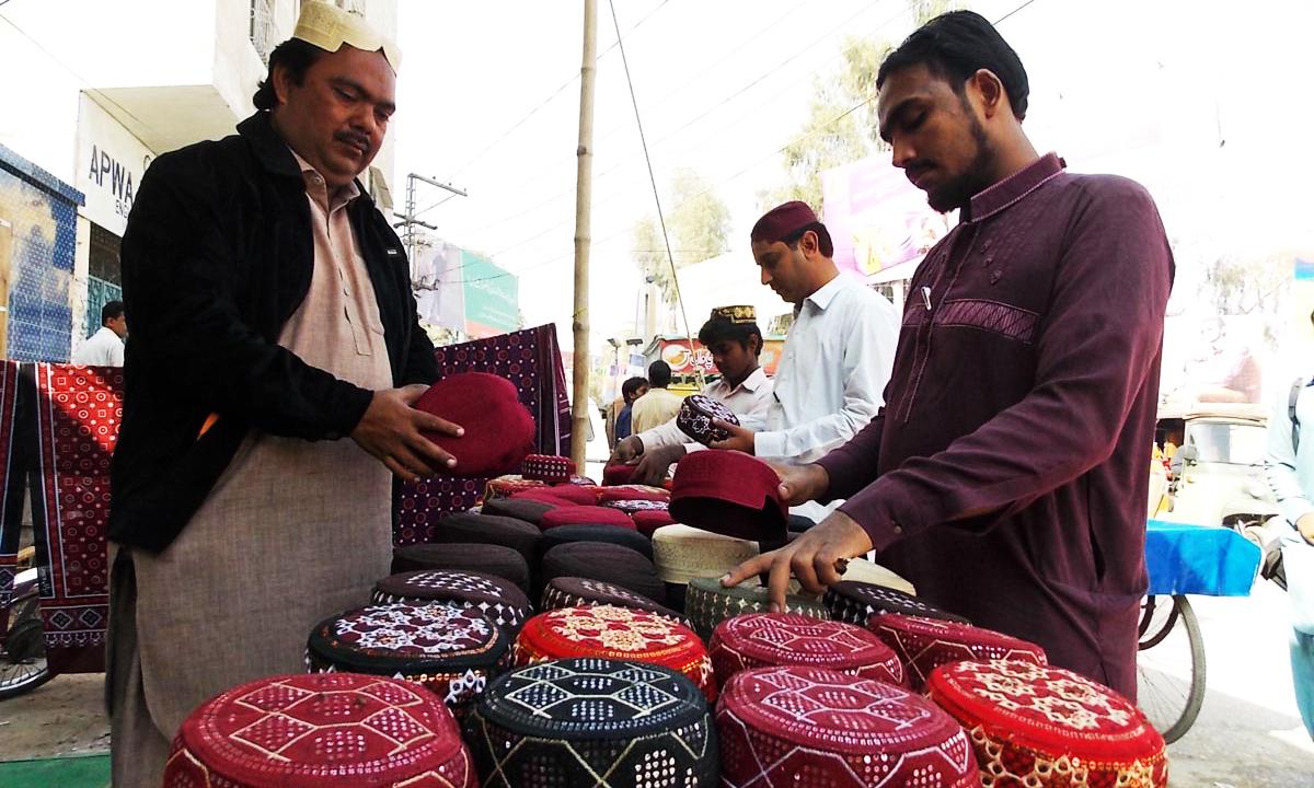 A vendor sells Sindhi caps in Sukkur. — ONLINE