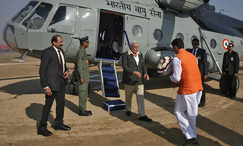 India's Prime Minister Narendra Modi (C) disembarks from an Indian Air Force helicopter upon his arrival to address an election campaign rally on the outskirts of Jammu. — Reuters