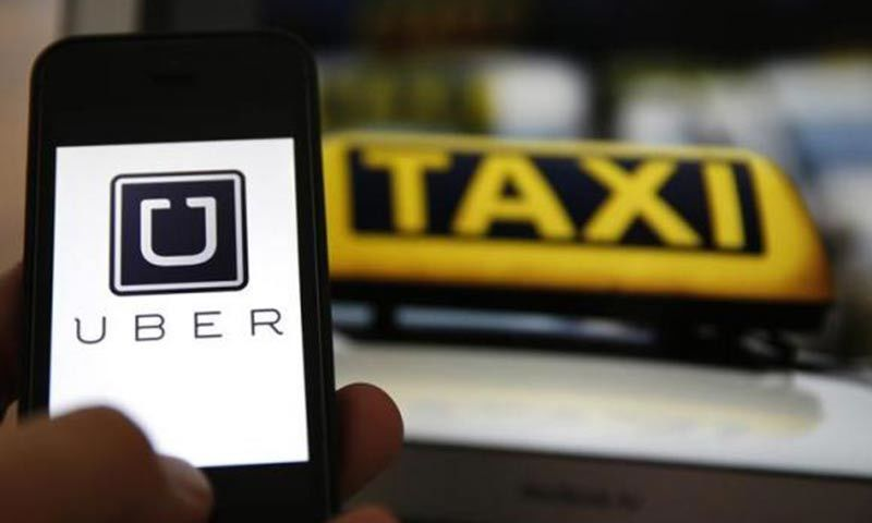 An illustration picture shows the logo of car-sharing service app Uber. — Reuters/File