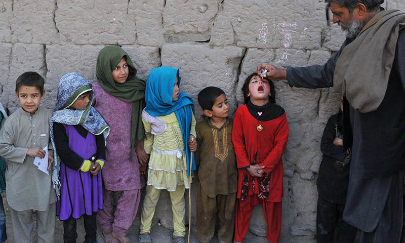 In this photo, a health worker administers polio vaccination to a child during a vaccination campaign. — AFP/File
