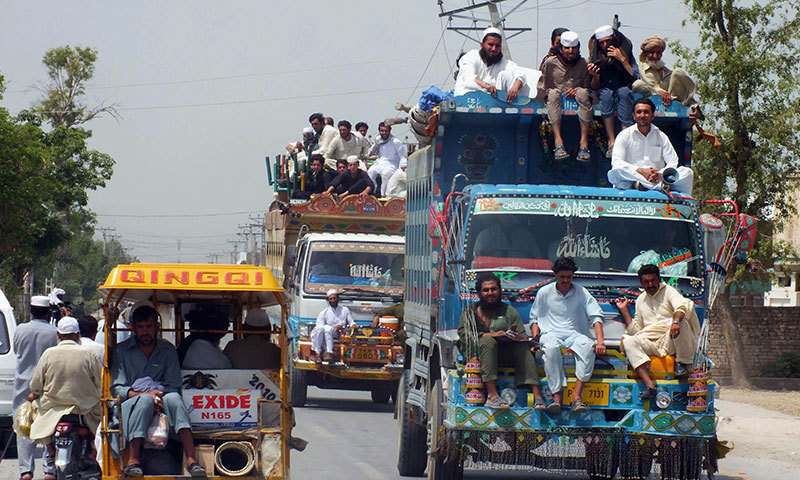 Tribesmen, fleeing from a military operation in North Waziristan tribal agency, arrive in Bannu district. — AFP/File
