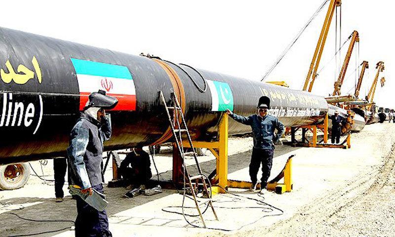 Iranian welders work on the proposed pipeline in Chabahar, near the Pakistani border, southeastern Iran. — AP/File