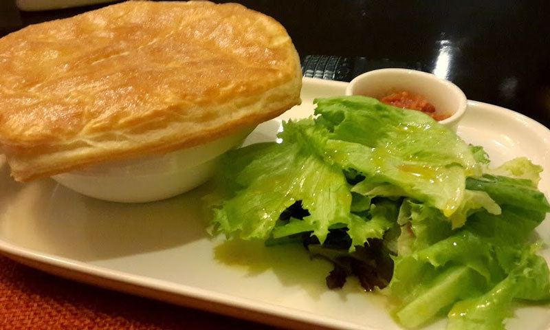Chicken Pot Pie with salad greens and tomato chutney. – Photo by author