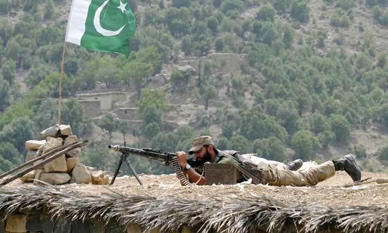 In this file photo, a Pakistani army soldier takes a position during a military operation against militants .—AP/File