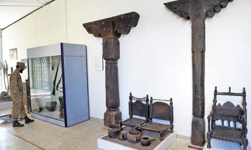 AN army man takes interest in antiquities at Swat Museum. — White Star