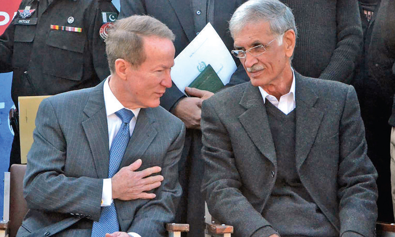 US Assistant Secretary of State Willian R Brownfi eld talks to Chief Minister Pervez Khattak at the launch of Joint Police Training Centre in Nowshera on Wednesday. — INP