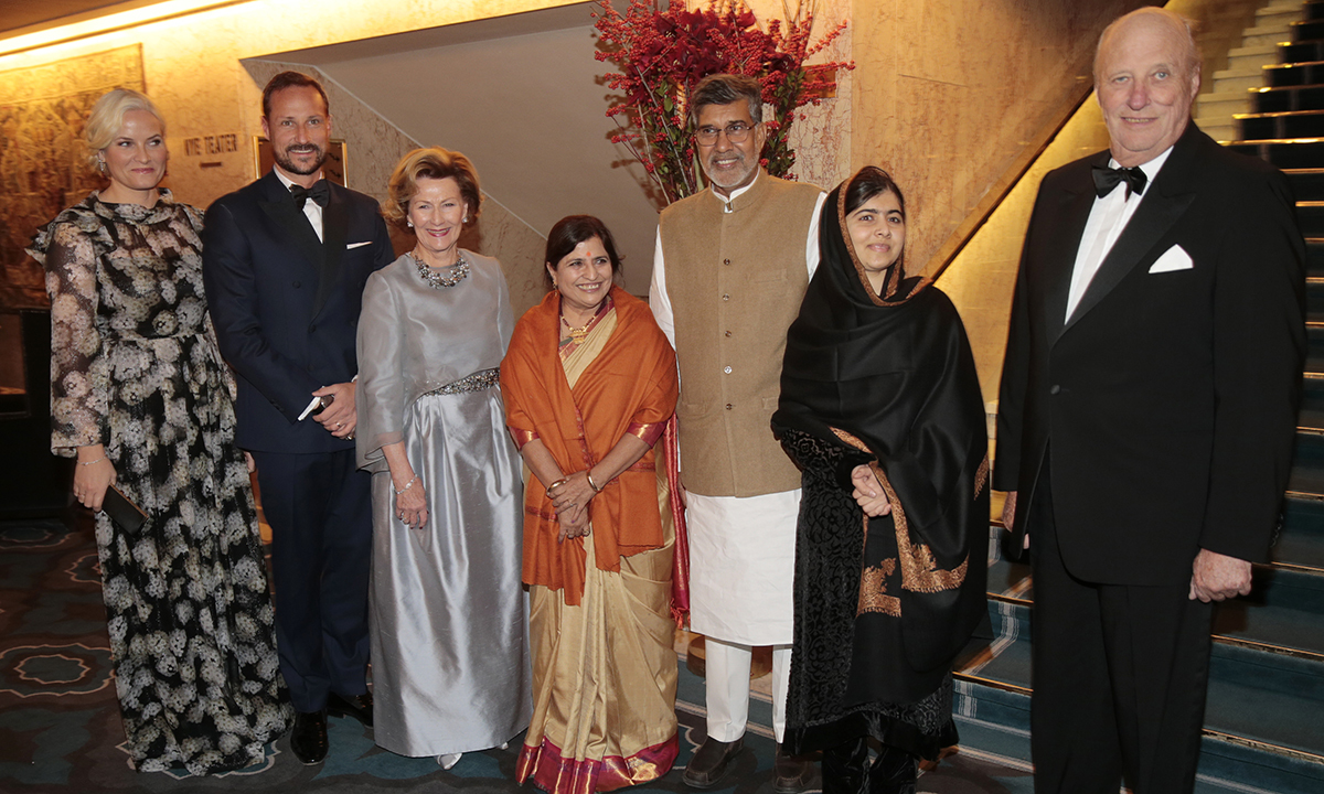 Guests of Honour at the Nobel Peace Prize banquet, with from left: Crown Princess Mette-Marit, Crown Prince Haakon, Queen Sonja, Peace Prize laureate Kailash Satyarthi with his wife Sumedha, and with Malala Yousafzai, 2nd right, and Norway's King Harald. — AP