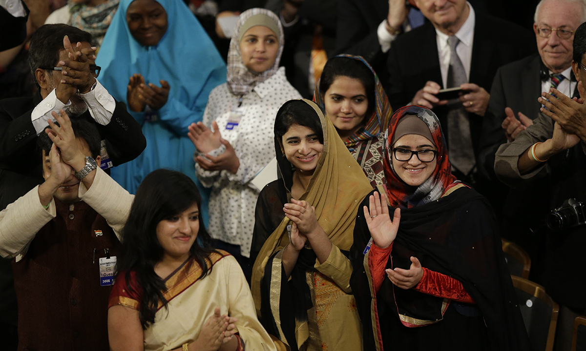 Guests of, Malala Yousafzai from left rear, Nigerian, Amina Yusuf, Syrian, Mezon Almellehan, Pakistan's Kainat Soomro, school friend, Shazia Ramzan, centre front, and school friend, Kainat Riaz, right, applaud and Malala Youzafzai enters the hall for the start of the presentation ceremony in Oslo.— AP