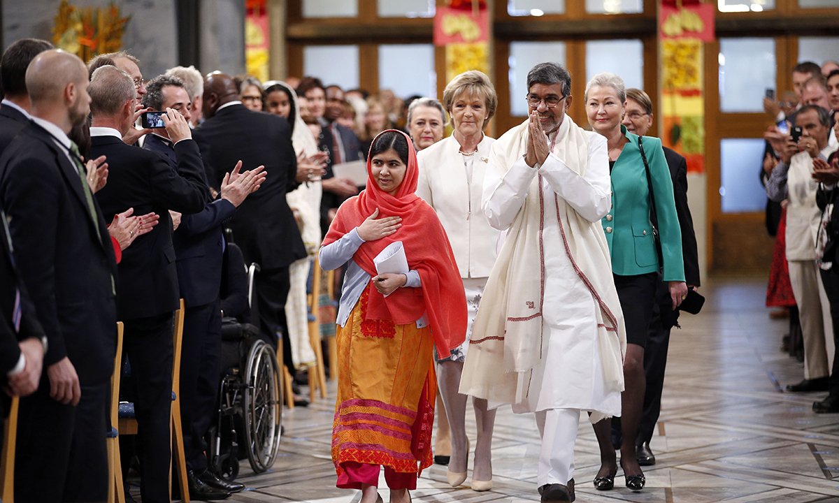 Laureates arrive for the Nobel Peace Prize award ceremony in Oslo. — AP