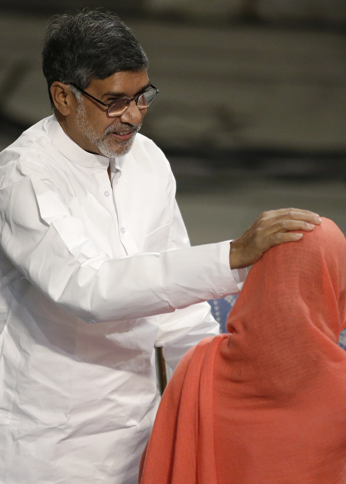 Nobel Peace Prize winner  Kailash Satyarthi of India,  places his hand on the head of joint winner Malala Yousafzai. . — AP