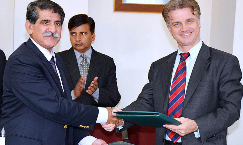 Secretary EAD, Saleem Sethi and Country Director ADB, Werner E. Liepach exchange documents after signing Loan and Project Agreements amounting to US$248 million in Islamabad on Friday. – APP