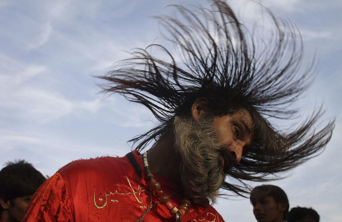A malang dances to celebrate the three-day annual congregation of  saint Data Ganjbaksh. - AP