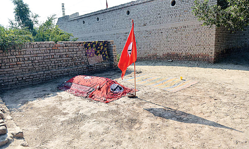 The grave of Sarwech Ali Pirzado, who was affiliated with the student wing of the Jeay Sindh Muttahida Mahaz, in Balhreji, Larkana district. — Fahim Siddiqi / White Star
