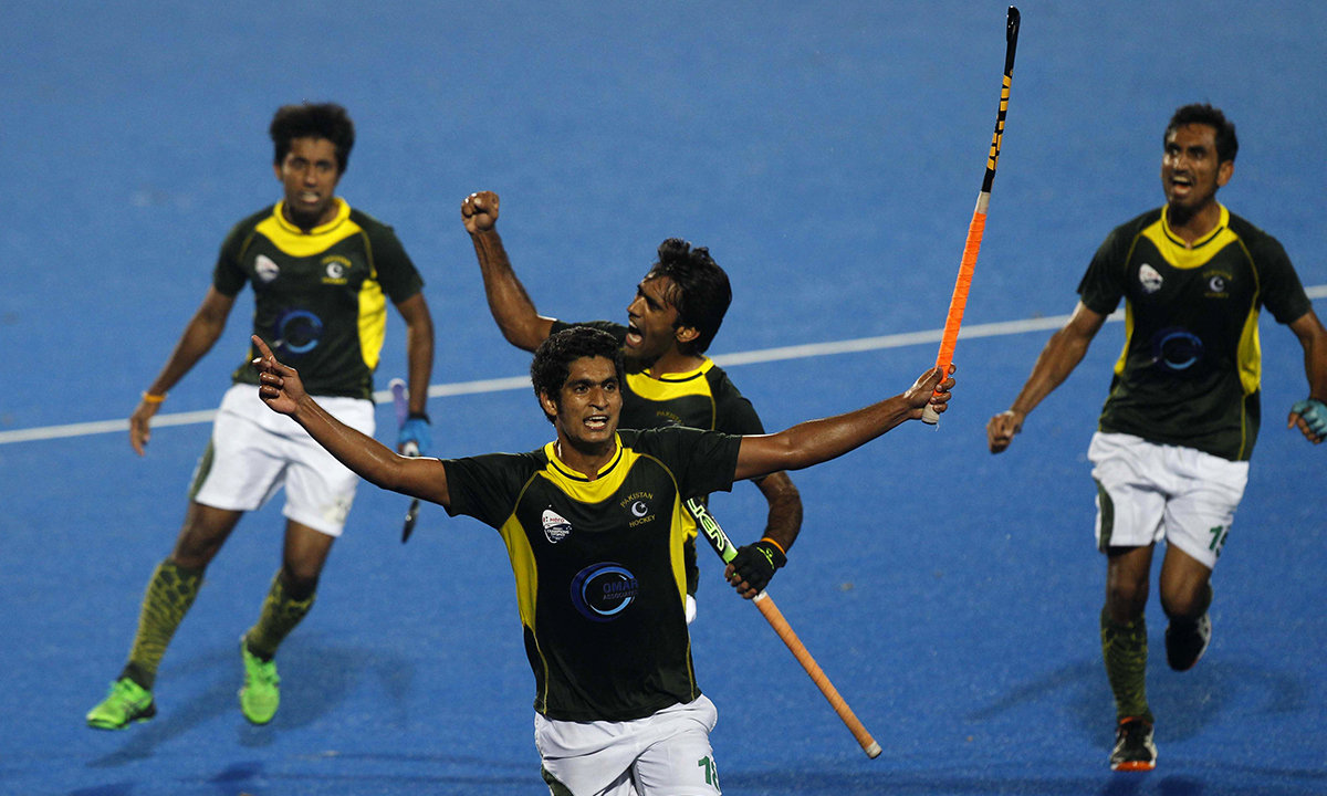 3e8dd1780ea Pakistani players celebrate their victory over India in the Champions  Trophy field hockey semifinal match in