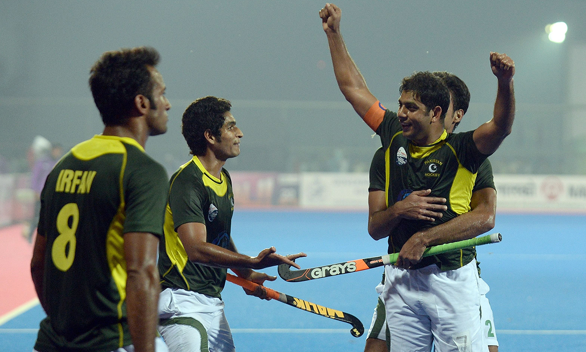 59cba112065 Pakistan hockey captain Mohammad Imran (2R) celebrates his team s victory  over India with teammates