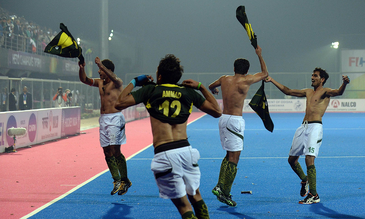 Pakistan hockey captain Mohammad Imran (L) and teammates take their jerseys off as they celebrate their victory over India with teammates during their Hero Hockey Champions Trophy 2014 semi final match in Bhubaneswar. — AFP