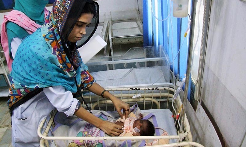 A doctor attending to a child from Tharparkar at Civil Hospital Hyderabad.- Online