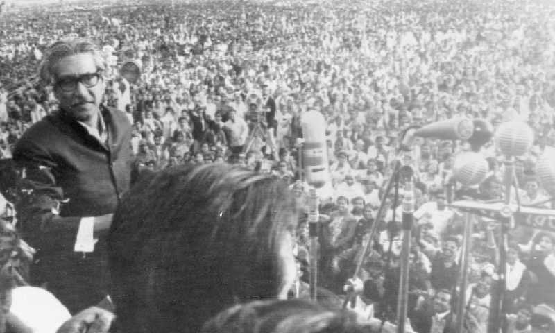 In this file photo Sheikh Mujibur Rehman approaches microphones to address a rally in Dhaka.