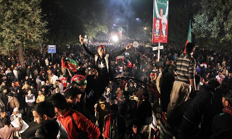 Supporters of Pakistan Tehreek-i-Insaf gather on the Mall near Punjab Assembly during strike called by the party in the provincial capital.— Online
