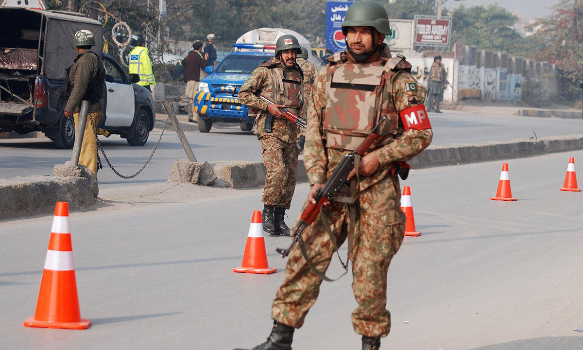 Pakistani security forces takes up positions on a road leading to the Army Public School. — Reuters