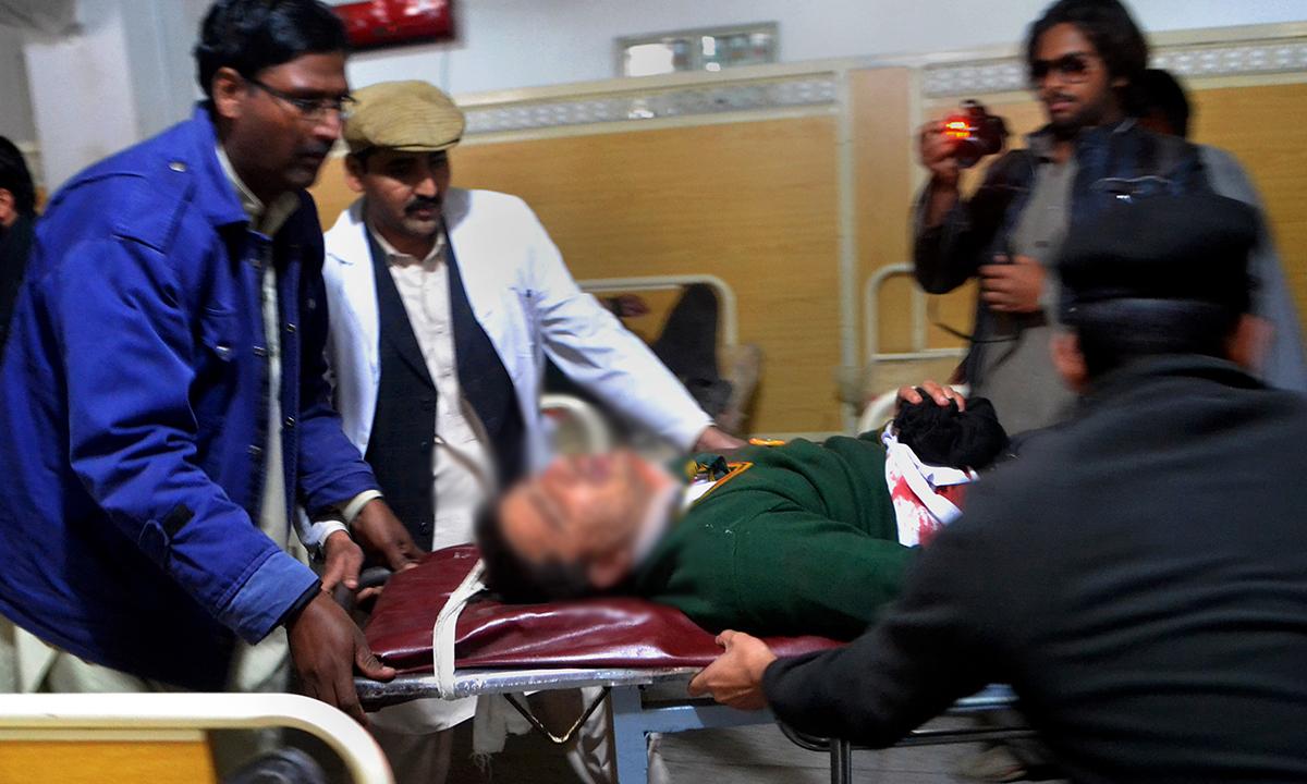 Hospital staff transport an injured student. — AP