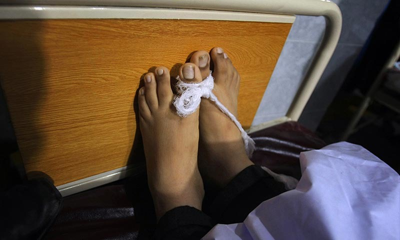 The feet of a victim of a Taliban attack in a school are tied together at a local hospital in Peshawar — AP