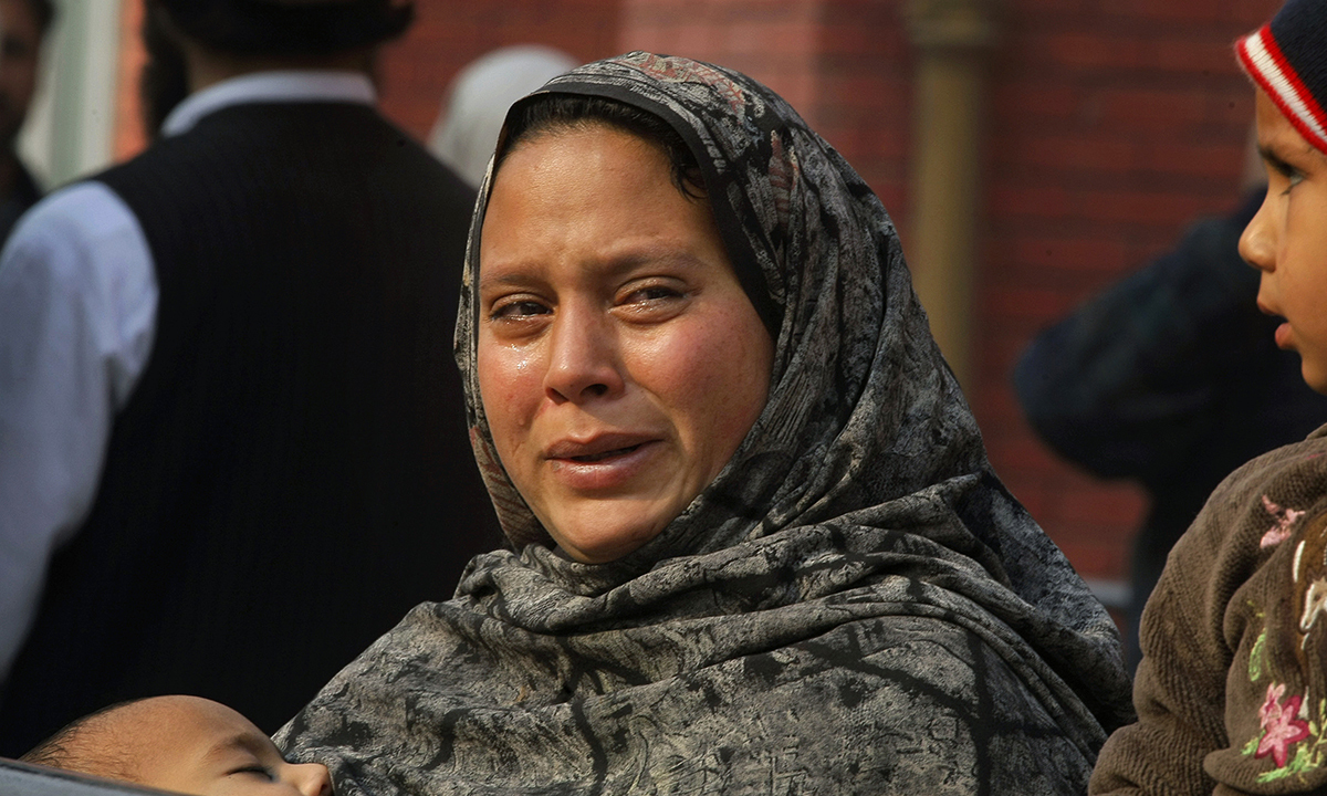 A Pakistani woman weeps as she waits at a hospital, where victims of a Taliban attack are being treated in Peshawar. — AP