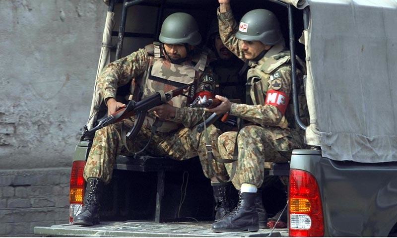 Army personnel arrive at the site of TTP attack on Army Public School situated on Warsak Road— INP