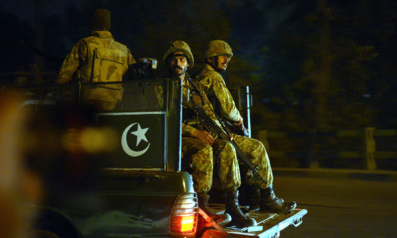 Pakistani army personnel patrol the streets following an attack by Taliban gunmen on a school in Peshawar on December 16, 2014. – AFP