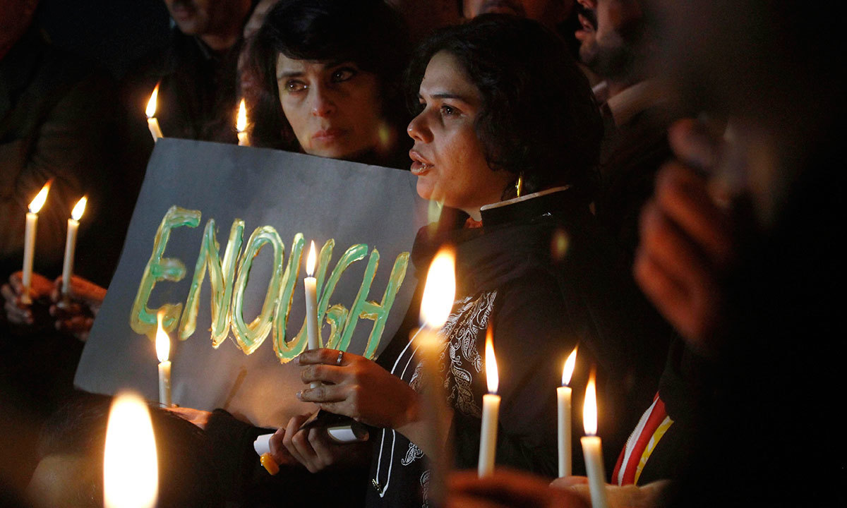 Civil society members take part in a candle light vigil for the victims of a school attacked by the Taliban in Peshawar, Dec 16, 2014 in Islamabad. - AP