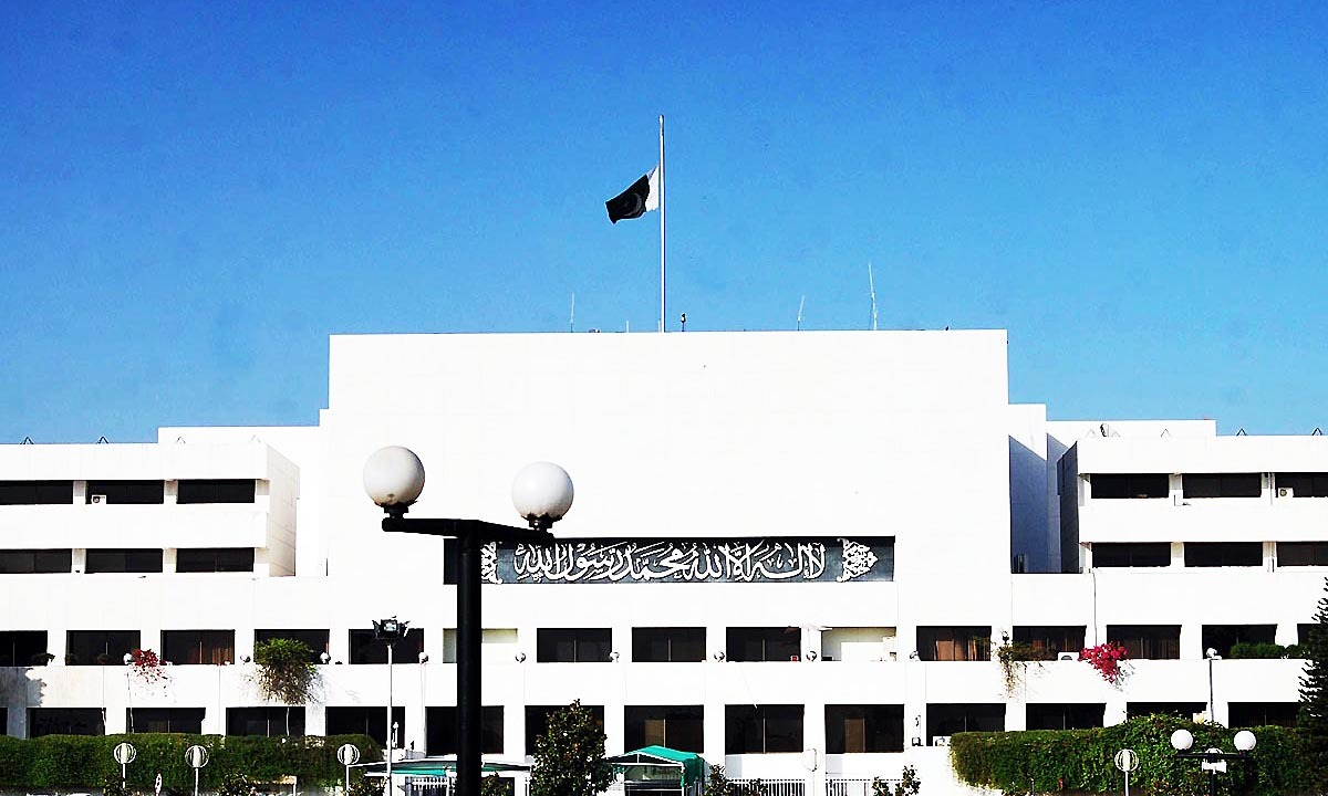 National flag is seen hoisted at half mast on the building of Parliament House. — Online
