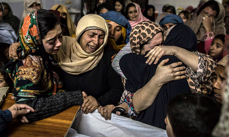 Women mourn their relative, a student who was killed during an attack by Taliban gunmen on the Army Public School, at his house in Peshawar, December 16, 2014.