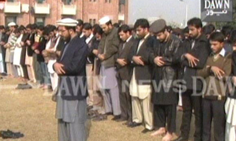 Prayers being held in Islamabad's International Islamic University. - DawnNews screengrab
