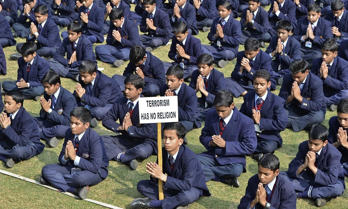 Schoolchildren take part in a prayer for victims of the Taliban attack on the Army Public School in Peshawar, in the northern Indian city of Mathura, December 17, 2014. — Reuters