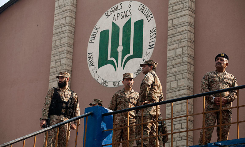 Army soldiers stand inside the Army Public School a day after Tuesday's attack, in Peshawar, Dec 17, 2014. - AP