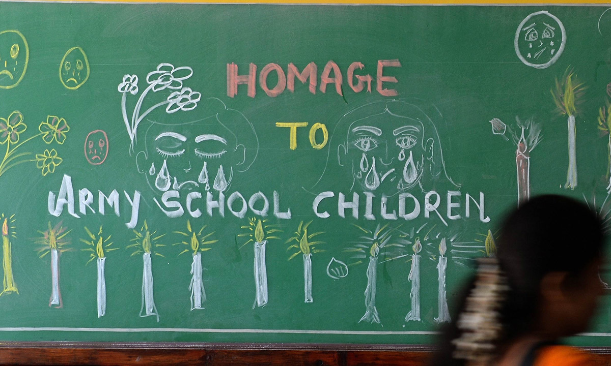 A blackboard adorned with a message from Indian schoolchildren at their school in Mumbai. — AFP