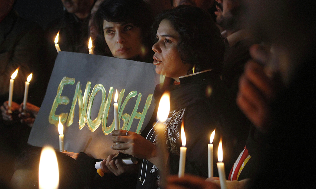 Candle light vigil in Islamabad. — AP