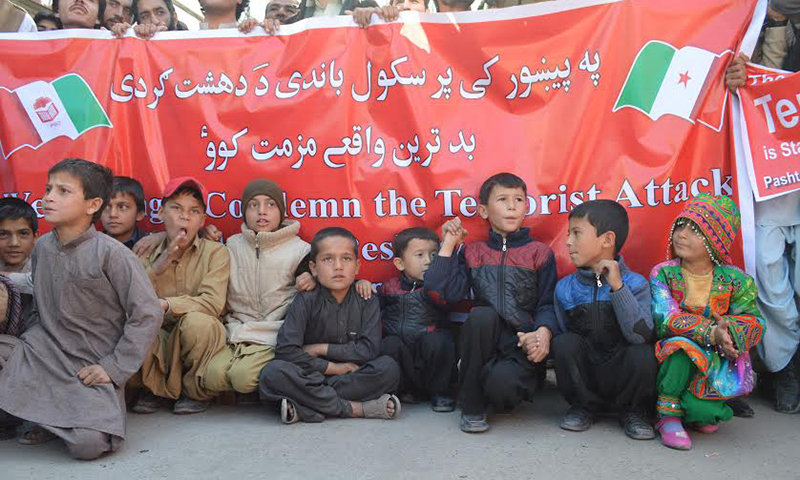 Activists of Pashtoonkhwa Students Organisation protesting against Peshawar carnage. — Photo by Syed Ali Shah
