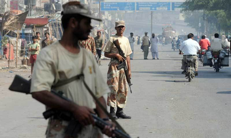 Rangers personnel stand guard on a street in Karachi. — AFP/File