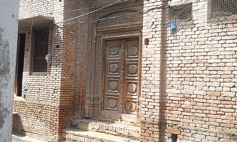 Carved wooden entrance of a relative's house